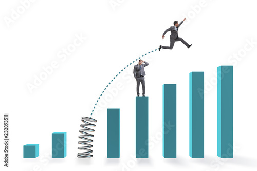 Tableau sur Toile Businessman outperforming his competition jumping over