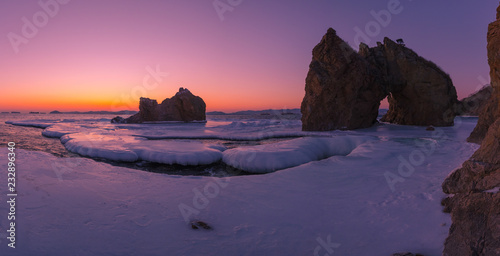 Canvas Prints Cuban Red Sunset on the sea, winter, snow, ice and rocks