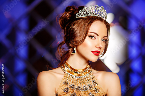 Obraz na płótnie Woman queen princess in crown and lux dress, lights party background Luxury girl Long shiny healthy volume hair Waves Curls
