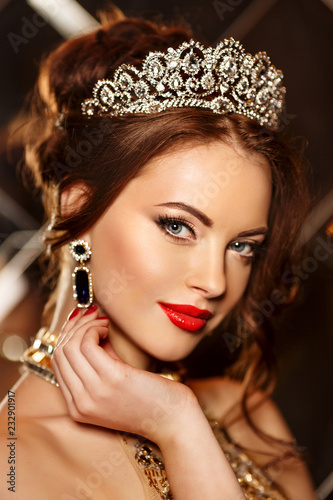 Leinwand Poster Woman queen princess in crown and lux dress, lights party background Luxury girl Long shiny healthy volume hair Waves Curls