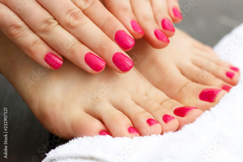 Foto op Canvas Pedicure Red manicure and pedicure