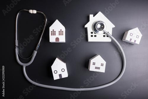 Fényképezés  House model with stethoscope isolated on black background