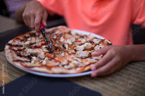 Wall Murals Pizzeria pizza in a plate and hands