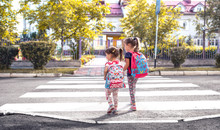 Children Go To School, Happy Students With School Backpacks And Holding Hands Together