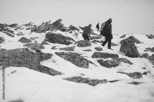 Staande foto Alpinisme The climbers down the mountain after climbing. Black and white.
