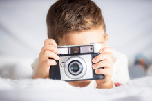 Beautiful Boy With A Photograp...