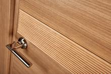 Closeup Photo Of Brown Wooden Door With Metal Handle