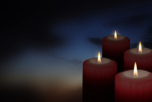 Four Christmas Candles In The Dark Sky