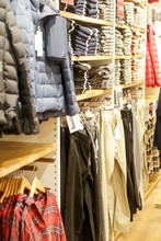 Clothing Shop Indoor, A Variety Of Clothes Displayed In The Shopping Mall