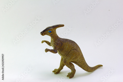 Photo  Dinosaurs of Parasaurolophus Plastic toy small white background