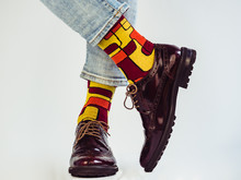 Men's Legs In Stylish, Vintage Shoes And Bright, Multi-colored Socks. White Background, Isolated, Close-up. Сoncept Of Fashion And Elegance