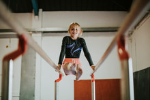 Young Gymnast On Parallel Bars