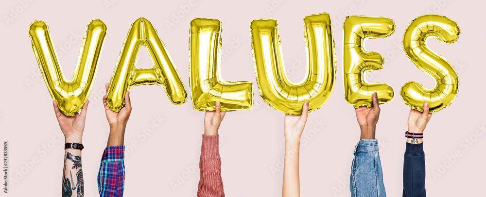 Fototapeta Hands holding values word in balloon letters