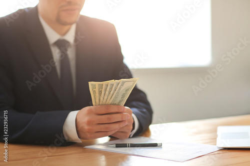 Businessman with bribe at table. Corruption concept Canvas-taulu
