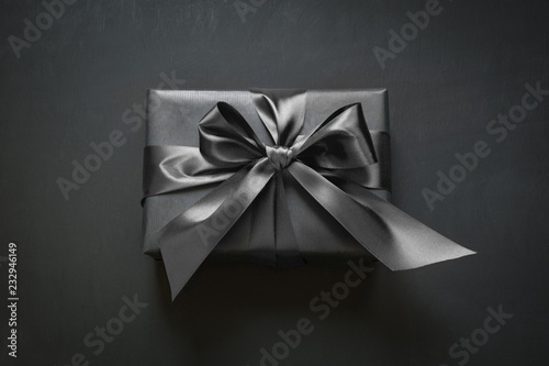 Photo  Gift box wrapped in black ribbon. Top view.