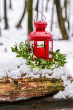 Red Lantern And Mistletoe Wreath In Winter Garden