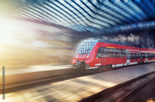 Fast train on the railway station. Composition with transport. Concept and idea at transportation item. Passenger train on the station