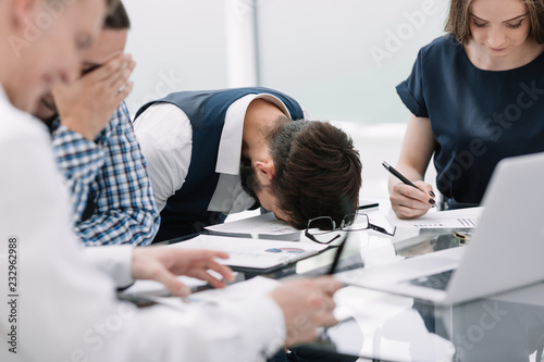 Obraz tired employee at a business meeting in the office - fototapety do salonu