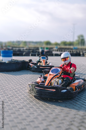 Go-Kart racing car on the track in action, championship