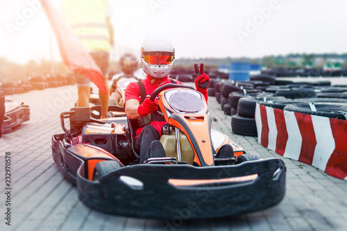 Fototapeta  Go-Kart racing car on the track in action, championship, active sports, extreme fun, the driver keeps his hands on the wheel