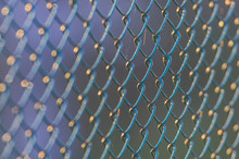 Diamond-shaped Steel Mesh Fence Close-up Background