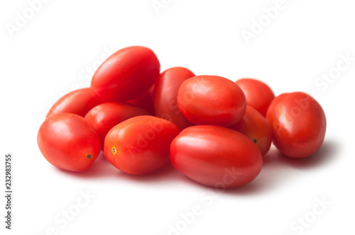 Leinwand Poster closeup of mini organic tomatoes roma on white background
