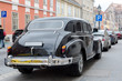 Black old school vintage car parked in old Budapest city street