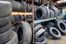 Car Old Used Tires Close Up. Pile Of Used Tires