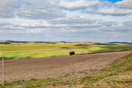 Staande foto Bleke violet A South Downs Farm Landscape with cloud shadows over the fields