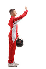 Fototapeta Young racer waving with his hand