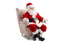 Surprised Santa Claus Sitting In An Armchair