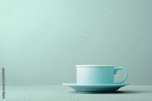 Turquoise cup on the table