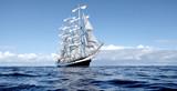 Sailing ship under white sails at the regatta - 232998924