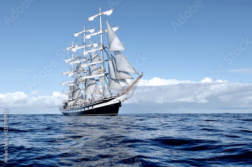 Foto auf Gartenposter Schiff Sailing ship under white sails at the regatta