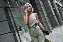 Fashion. Young Stylish Woman Walking On The City Street