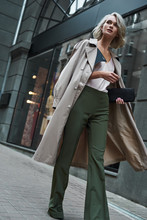 Fashion. Young Stylish Woman Walking On The City Street Looking Aside Curious Full Body Shot