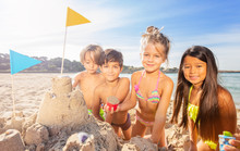 Funny Kids Building Sandcastle Using Sandpit Toys