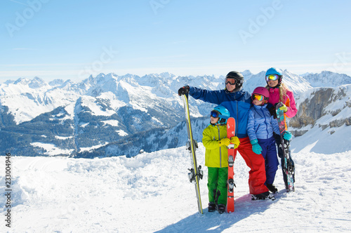 Pinturas sobre lienzo  Happy family enjoying winter vacations in mountains