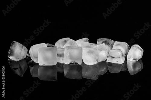 Photo  Ice cubes isolated on black background.