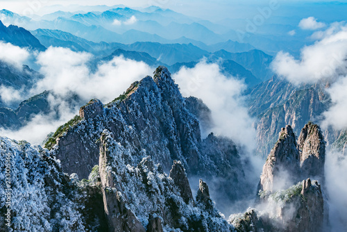 Clouds by the mountain peaks of Huangshan National park. China