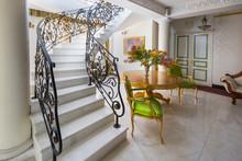Staircase With Handmade Wrought Iron Railing. Luxury Lobby Interior