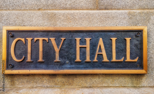 Exterior sign that reads City Hall in brass letters. Wallpaper Mural