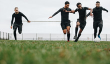 Soccer Players Playing Football On The Field