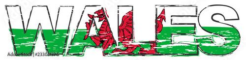 Fototapeta Word WALES with Welsh flag under it, distressed grunge look.