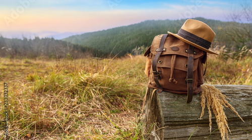 Looking image of travelling concept, backpack and hat . Vacation in mountains.