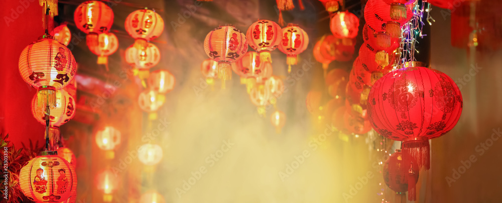 Fototapeta Chinese new year lanterns in chinatown.Text mean happiness and good health