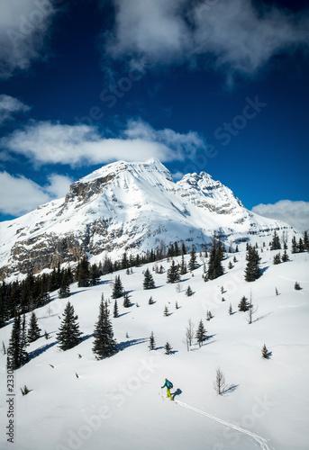 Snow covered mountain and hiker in winter, Lake O'Hara, Yoho National Park, Alberta, Canada