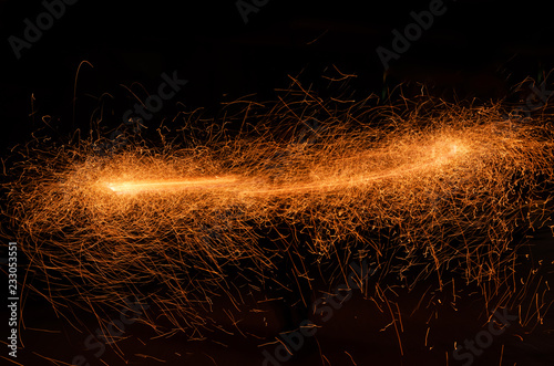 Fotografering Firestorm from particles of sparks of fire