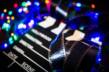 Fototapeta na wymiar Movie film unrolled on Christmas light