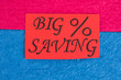 canvas print picture - Red card with message big saving. Paper card with inscription big saving on colorful paper background. Shopping savings concept.